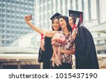 they enjoyed the graduation... | Shutterstock . vector #1015437190
