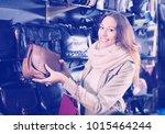 beautiful girl choosing bag... | Shutterstock . vector #1015464244