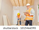 experienced craftsman with... | Shutterstock . vector #1015466590