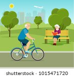 grandfather riding a bicycle in ... | Shutterstock .eps vector #1015471720