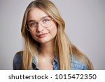 glasses girl smiling to camera  ... | Shutterstock . vector #1015472350