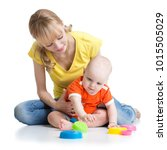 baby and mommy playing together ... | Shutterstock . vector #1015505029