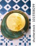 turmeric latte or golden milk... | Shutterstock . vector #1015508299