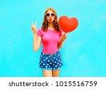 pretty woman makes an air kiss... | Shutterstock . vector #1015516759