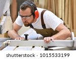 young carpenter in working... | Shutterstock . vector #1015533199