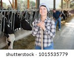 confident female farmer posing... | Shutterstock . vector #1015535779
