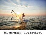 a young guy  an athlete raises... | Shutterstock . vector #1015546960