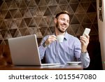 handsome young man workin on... | Shutterstock . vector #1015547080