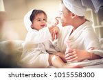 playful with mommy after bath.... | Shutterstock . vector #1015558300