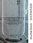 Small photo of Air bubbles from the aeration system go up through the liquid medium of a photobioreactor biologic reactor for the growth of microalgae for a scientific experiment