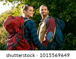 tourist couple traveling ... | Shutterstock . vector #1015569649