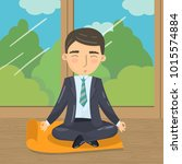 businessman meditating in yoga... | Shutterstock .eps vector #1015574884