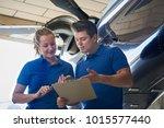 aero engineer and apprentice... | Shutterstock . vector #1015577440