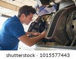 male aero engineer working on... | Shutterstock . vector #1015577443