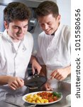 chef instructing male trainee... | Shutterstock . vector #1015580656