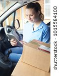 female courier in van with... | Shutterstock . vector #1015584100