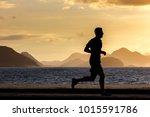 A Man Runs On Copacabana Beach...