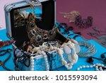 jewelry in a blue jewelry box.... | Shutterstock . vector #1015593094