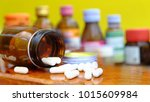 pour the white pills out of the ... | Shutterstock . vector #1015609984
