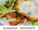 "Small photo of Thai food name ""Phat Ka Na Mho Grob kai Dow"" (Kale Crispy pork and Fried egg) in foam box."