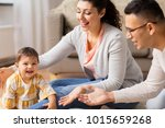 family  parenthood and people... | Shutterstock . vector #1015659268