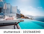 beach bed chair with towel... | Shutterstock . vector #1015668340