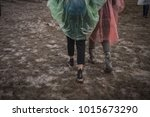 in rubber boots on dirt  at the ... | Shutterstock . vector #1015673290