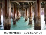 under a pier  clear turquoise... | Shutterstock . vector #1015673404