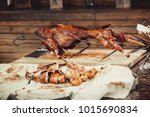 whole grilled lamb on cutting... | Shutterstock . vector #1015690834