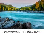 Small photo of River flowing out of the Kanas Lake at Autumn, Xinjiang, China, The tree color is changed to yellow, Sky beautiful on the background.