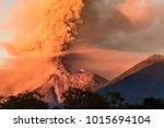 fuego volcano erupting at dawn... | Shutterstock . vector #1015694104