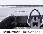 black text fake news written on ... | Shutterstock . vector #1015694470