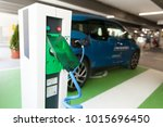 charging battery of an electric ... | Shutterstock . vector #1015696450