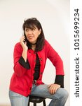 lady talking on the phone with... | Shutterstock . vector #1015699234
