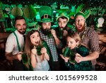 the company of young people... | Shutterstock . vector #1015699528