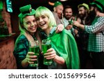 two girls in a wig and a cap... | Shutterstock . vector #1015699564