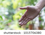 woman hand with bokeh... | Shutterstock . vector #1015706380