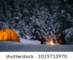 couple camping with campfire... | Shutterstock . vector #1015713970