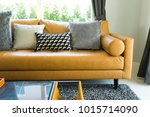 luxury cushion on brown leather ... | Shutterstock . vector #1015714090