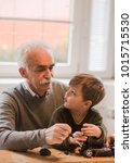 grandpa teaching son how to... | Shutterstock . vector #1015715530