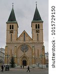 Small photo of Sarajevo, Bosnia and Herzegovina - December 18, 2017: people are walking at the Cathedral of the Sacred Heart in Sarajevo