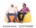 two friends sitting on beanbags ... | Shutterstock . vector #1015746280