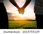couple holding hands and... | Shutterstock . vector #1015755139