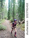 Small photo of LEADVILLE, COLORADO USA - AUGUST 19, 2017: Caroline Veltri outbound from the Twin Lakes aid station during the Leadville Trail 100 Ultra, Leadville, Colorado, USA.