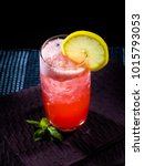 a glass of sea breeze cocktail | Shutterstock . vector #1015793053