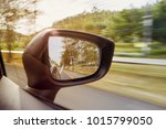 focus on car side mirror when... | Shutterstock . vector #1015799050