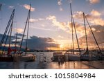 beautiful sunset on the shore... | Shutterstock . vector #1015804984