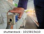 hand pressing emergency stop... | Shutterstock . vector #1015815610