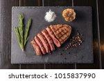 sliced prime ribeye steak on... | Shutterstock . vector #1015837990