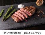 sliced prime ribeye steak on... | Shutterstock . vector #1015837999